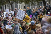 Mothers holding up babies, Extinction Rebellion protest against lack of Government action on climate change. Nonviolent direct action shutting down central London. - Jess Hurd - 09-10-2019