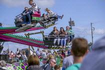 Fairground ride, Torbay Airshow 2017 - Paul Box - 2010s,2017,air show,air shows,air transport,Airshow,AIRSHOWS,child,CHILDHOOD,children,fairground,fairgrounds,female,females,Funfair,funfairs,girl,girls,having fun,juvenile,juveniles,kid,kids,Leisure,L