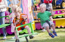 Swing ride, Funfair, Torbay Airshow 2017 - Paul Box - 2010s,2017,air show,air shows,air transport,Airshow,AIRSHOWS,boy,boys,child,CHILDHOOD,children,fairground,fairgrounds,Funfair,funfairs,having fun,juvenile,juveniles,kid,kids,Leisure,LFL,LIFE,male,peop