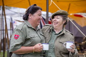 Dressed up as Army women, Torbay Airshow 2017 - Paul Box - 2010s,2017,air show,air shows,air transport,Airshow,AIRSHOWS,army,costume,costumes,dressed up,dressing up,EMOTION,EMOTIONS,fancy dress,FEMALE,happiness,happy,having fun,HUMOUR,laugh,laughing,laughter,
