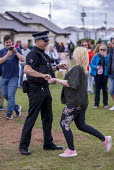 Policeman dancing, Torbay Airshow 2017 - Paul Box - 2010s,2017,air show,air shows,air transport,Airshow,AIRSHOWS,CLJ,community policing,dance,dancer,dancers,dancing,EMOTION,EMOTIONS,FEMALE,force,happiness,happy,having fun,HUMOUR,laugh,laughing,laughter