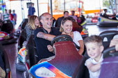 Dodgems, Fairground, Torbay Airshow 2017 - Paul Box - 2010s,2017,air show,air shows,air transport,Airshow,AIRSHOWS,AUTO,AUTOMOBILE,AUTOMOBILES,bumper cars,car,cars,DAD,DADDIES,DADDY,DADS,Dodgems,driver,drivers,driving,fairground,fairgrounds,FAMILY,father