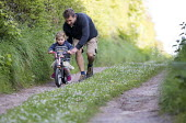 Farther helping daughter to learn to ride a bike, Bangeston, Angle, Pembrokeshire - Paul Box - 03-05-2017