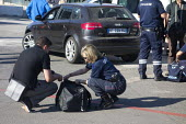 Customs officers searching passenger luggage, Bastia, Corsica, France - Paul Box - 02-07-2013