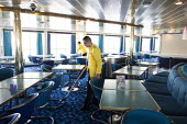 Cleaners working, Corsica Ferries - Sardinia Ferries ship, Nice, France - Paul Box - 2010s,2013,boat,boats,cleaner,cleaners,cleaning,cleansing,Corsica,Corsican,Corsicans,crew,crewman,crewmen,crewmenmaritime,dock,docked,docks,dockside,EARNINGS,EBF,Economic,Economy,employee,employees,Em