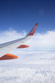 View of a wing from the window of an EasyJet plane over Portugal - Paul Box - 2010s,2018,aeroplane,aeroplanes,air transport,aircraft,airline,airplane,airplanes,altitude,aviation,cloud,clouds,companies,company,fleet,flight,flights,flown,fly,flying,holiday,holiday maker,holiday m