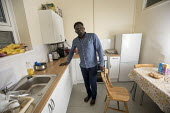 Sudanese refugee living in a home renovated by Ashley Community housing, Bristol - Paul Box - 2010s,2018,African,Africans,BAME,BAMEs,Black,BME,bmes,building,buildings,communities,Community,Diaspora,displaced,diversity,ethnic,ethnicity,foreigner,foreigners,home,homes,house,houses,Housing,immigr