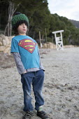 Boy on a family holiday, Formentor Playa beach, Mallorca, Spain. He has autism - Paul Box - 2010s,2018,autism,autistic,beach,BEACHES,Behavioural,Boy,BOYS,child,children,COAST,country,countryside,difficulties,disorder,disorders,families,family,HEA,Health,holiday,holiday maker,holiday makers,h