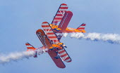 AeroSuperBatics Wingwalkers Flying Circus, Torbay airshow, Torbay. 1940s Boeing Stearman biplanes - Paul Box - 2010s,2018,aerial display,aerial displays,aerial stunt,aerial stunts,aerobatic,aerobatics,aeroplane,aeroplanes,air show,air shows,air transport,aircraft,airplane,airplanes,airshow,AIRSHOWS,aviation,bi