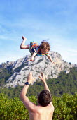 Farther throwing his daughter in the air, Family holiday, Mallorca, Spain - Paul Box - 11-05-2014