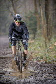 Cyclo-cross riders in the woods, Bristol. Cyclo-cross is a form of off-road cycle racing - Paul Box - 2010s,2018,bicycle,bicycles,BICYCLING,Bicyclist,Bicyclists,BIKE,BIKES,club,clubs,country,countryside,cycle,cycles,cycling,Cyclist,Cyclists,Endurance,exercise,exercises,exercising,helmet,helmets,hobbie