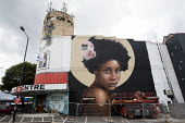 Black woman with Afro and flower Rosk & Loste mural, UPFEST 2018, Street Art and Graffiti Festival, Bristol. Redpoint Climbing Centre - Paul Box - 2010s,2018,art,artwork,artworks,Bristol,Climbing,FEMALE,Festival,FESTIVALS,graffiti,mural,murals,Painting,paintings,PEOPLE,person,persons,Street,street art,style,wall painting,woman,women