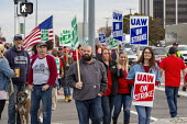 Warren, Michigan, USA: UAW picketing GM Technical Center in the fourth week of their strike. The strike's main issues include plant closings, wages, the two-tier pay structure, temporary workers, and... - Jim West - 2010s,2019,4th,AFL CIO,AFL-CIO,american,americans,automotive,Car Industry,carindustry,DISPUTE,disputes,EARNINGS,FEMALE,Flag,flags,fourth,General Motors,GM,Industrial dispute,member,member members,memb