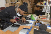 Detroit, Michigan, USA: An Air Force veteran making footwear, Pingree Detroit. Pingree is a worker owned company that hires veterans to make footwear and other products with leather reclaimed from the... - Jim West - 2010s,2019,African American,African Americans,America,BAME,BAMEs,black,BME,bmes,by hand,capitalism,co operative,co operatives,company,cooperative,co-operative,cooperatives,co-operatives,craft,craftsma