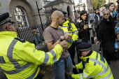 Police stop and search Extinction Rebellion, last day protesting against lack of Government action on climate change, Whitehall, London. - Jess Hurd - 18-10-2019