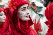 The Invisible Circus, Extinction Rebellion activists dressed in red robes and with white makeup. Extinction Rebellion red hand, last day protesting against lack of Government action on climate change.... - Jess Hurd - 18-10-2019