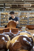 Michigan, USA: worker polishing wooden bowls, The Holland Bowl Mill, which manufactures bowls and other wood products - Jim West - 2010s,2019,bowl,bowl making,bowls,by hand,capitalism,craft,craftsman,EBF,Economic,Economy,employee,employees,Employment,FACTORIES,factory,FEMALE,handmade,hardwood,Holland Bowl Mill,Industries,industry