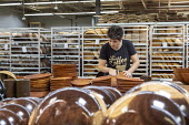 Michigan, USA: worker polishing wooden bowls, The Holland Bowl Mill, which manufactures bowls and other wood products - Jim West - 10-10-2019