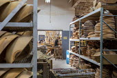 Michigan, USA: worker sanding wooden bowls, The Holland Bowl Mill, which manufactures bowls and other wood products - Jim West - 10-10-2019