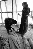 Woman grieving over her dead child, Ethiopian famine 1984, Bati relief centre, Ethiopia - Masanori Kobayashi - 1980s,1984,adult,adults,africa,African,Africans,bodies,body,camp,camps,child,CHILDHOOD,children,cry,crying,dead,death,deaths,developing world,dia,died,disaster,DISASTERS,emotion,emotional,emotions,eth