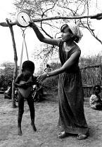 Aid worker weighing a malnourished child, Somalia, 1980 - Masanori Kobayashi - 03-05-1980