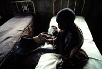 Famine, Ethiopia, 1984, Sudanese refugee child orphaned by the famine and war, Fugnido Orphanage Camp - Masanori Kobayashi - 03-05-1990