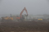 Construction of new housing, morning mist, Stratford upon Avon, Warwickshire. Spitfire Homes - John Harris - 2010s,2019,autumn,autumnal,BUILDING,building site,CLIMATE,conditions,Construction,Construction Industry,country,countryside,development,digger,diggers,earth moving equipment,EBF,Economic,Economy,emplo