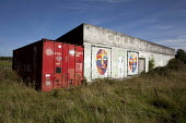 Shipping container used by migrant workers, Lougrea, Ireland - David Mansell - 2010s,2012,accommodation,ACE,agricultural,agriculture,art,arts,artwork,artworks,capitalism,container,containers,culture,EBF,Economic,Economy,eurozone,farm,farmed,farming,farmland,farms,foreign,foreign