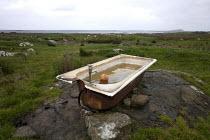 Old enamel tin bath used to water sheep, Connemara, Ireland - David Mansell - 25-09-2012