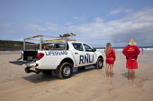St Ives, Cornwall, RNLI Lifeguards keeping watch on swimmers, Porthmeor Beach - David Mansell - 2010s,2015,4x4,AUTO,AUTOMOBILE,AUTOMOBILES,beach,BEACHES,car,cars,COAST,DIA,employee,employees,Employment,FEMALE,Four By Four,hazard,hazardous,hazards,holiday,holidaymaker,holidaymakers,holidays,incid