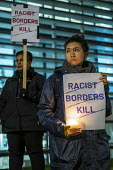 Vigil after 39 tragic migrant deaths, Home Office, London. Racist Border Kill. End the hostile environment called by Stand up to Racism - Jess Hurd - 2010s,2019,activist,activists,against,BAME,BAMEs,bigotry,BME,bmes,Border,border control,border controls,borders,CAMPAIGNING,CAMPAIGNS,candle,candlelight vigil,Candlelit Vigil,candles,chinese,death,dea
