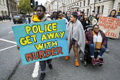 Annual United Families and Friends Campaign march against deaths in police custody, Whitehall, Westminster, London. - Jess Hurd - 2010s,2019,activist,activists,adult,adults,against,annual,BAME,BAMEs,Black,BME,bmes,bound,Campaign,campaigner,campaigners,CAMPAIGNING,CAMPAIGNS,custody,death,death in police custody,deaths,DEMONSTRATI
