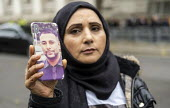 Justice for Mohammed Yassar Yaqub, parents joins annual United Families and Friends Campaign march against deaths in police custody, Whitehall, Westminster, London. - Jess Hurd - 2010s,2019,activist,activists,adult,adults,against,annual,BAME,BAMEs,Black,BME,bmes,Campaign,campaigner,campaigners,CAMPAIGNING,CAMPAIGNS,custody,death,death in police custody,deaths,DEMONSTRATING,dem