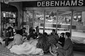 Debenhams sale Oxford Street, London 1977 shoppers camping out all night to be first in for the Debenhams sale - Martin Mayer - 1970s,1977,1st,bought,buy,buyer,buyers,buying,camping,cities,City,consumer,consumers,customer,customers,Debenhams,department store,EBF,Economic,Economy,FEMALE,first,line,London,male,man,men,outlet,out