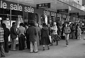 Debenhams sale Oxford Street, London 1977 crowds queuing outside the store during post Christmas sale - Martin Mayer - 1970s,1977,bought,busy,buy,buyer,buyers,buying,Christmas,cities,City,consumer,consumers,customer,customers,Debenhams,department store,EBF,Economic,Economy,FEMALE,London,outlet,outlets,outside,Oxford,O