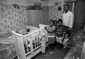 Family in over crowded Hackney housing 1973. A black family with 5 children living in cramped conditions in a council flat, London - Martin Mayer - 01-05-1973