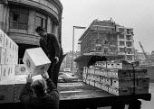 Workers loading boxes of fruit onto a lorry, Long Acre, Covent Garden 1973 before the market moved to Nine Elms - Martin Mayer - 30-01-1973