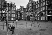Children playing on swings, Brixton housing estate, London 1974 - Martin Mayer - 02-05-1974