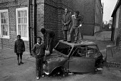 Boys playing on a burnt out car, Brixton housing estate, London 1974 - Martin Mayer - 02-05-1974