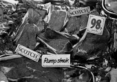 Scotch rump steak for sale in butchers London 1977 - NLA - 1970s,1977,beef,butcher,butchers,buy,buyer,buyers,buying,cities,City,EBF,Economic,Economy,food,FOODS,inflation,London,meat,outlet,outlets,Price,prices,purchase,purchaser,purchasing,retail,RETAILER,RET