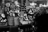 Fortnum & Mason luxury Christmas hampers 1975 two affluent women eye up a Golden Hamper at luxury food store Fortnum and Mason, Piccadilly, London - NLA - 23-12-1975