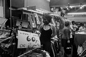 Young black woman shopping, Brixton market, London 1972 - Peter Arkell - 1970s,1972,apparel,BAME,BAMEs,Black,black woman,BME,bmes,bought,Brixton,Brixton market,buy,buyer,buyers,buying,cities,City,clothes,clothing,consumer,consumers,customer,customers,diversity,EBF,Economic