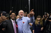 Jeremy Corbyn speaking Labour Party Election Campaign Rally, Swindon - John Harris - 2010s,2019,Asian,Asians,audience,AUDIENCES,BAME,BAMEs,Black,Black and White,BME,bmes,CAMERA,camera phone,cameras,campaign,campaigning,CAMPAIGNS,DEMOCRACY,diversity,Election,elections,ethnic,ethnicity,