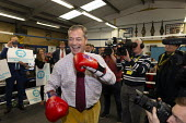 Nigel Farage, Brexit Party Election Campaign, Bolsover, Derbyshire - John Harris - 2010s,2019,boxing club,Boxing Gloves,boxing ring,Brexit,Brexit Party,camera,cameras,Campaign,CAMPAIGNING,CAMPAIGNS,communicating,communication,DEMOCRACY,Election,ELECTIONS,Far Right,Far Right,media,me