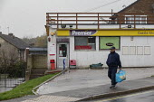 Elderly retired miner passing a Premier shop, on his way to hospital, Bolsover, Derbyshire - John Harris - 2010s,2019,adult,adults,age,ageing population,bag,bags,CLIMATE,conditions,Corner Shop,Council Housing,Council Housing,deindustrialisation,deindustrialization,EBF,Economic,Economy,elderly,excluded,excl