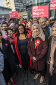 Apsana Begum General Election Labour Party campaign launch with Diane Abbott MP in Chrisp Street Market for Poplar and Limehouse constituency, East London. - Jess Hurd - 2010s,2019,Apsana Begum,Asian,Asians,BAME,BAMEs,Bengali,bengalis,Black,BME,bmes,campaign,campaigning,CAMPAIGNS,candidate,candidates,Chrisp Street,cities,City,constituency,DEMOCRACY,Diane Abbott,divers