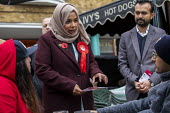 Apsana Begum General Election Labour Party campaign launch, Chrisp Street Market for Poplar and Limehouse constituency, East London. - Jess Hurd - 2010s,2019,Apsana Begum,Asian,Asians,BAME,BAMEs,Bengali,bengalis,Black,BME,bmes,campaign,campaigning,CAMPAIGNS,candidate,candidates,CANVASING,canvassing,Chrisp Street,cities,City,communicating,communi