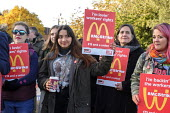 McDonalds workers on strike over low pay, picket Wandsworth Town branch, London - Philip Wolmuth - 2010s,2019,banner,banners,BFAWU,branch,BRANCHES,DISPUTE,disputes,EARNINGS,employment,FEMALE,Income,industrial dispute,Living Wage,London,London Living Wage,low pay,Low Income,low paid,low pay,McDonald