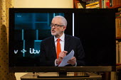 ITV general election debate, Boris Johnson, Jeremy Corbyn debating on TV. Corbyn confronting Johnson with papers from US Trade talks highlighting a secret plan to sell offNHS to American corporations - John Harris - 19-11-2019