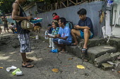 Manila, Philippines: vendor and people eating in the street - David Bacon - 27-09-2019